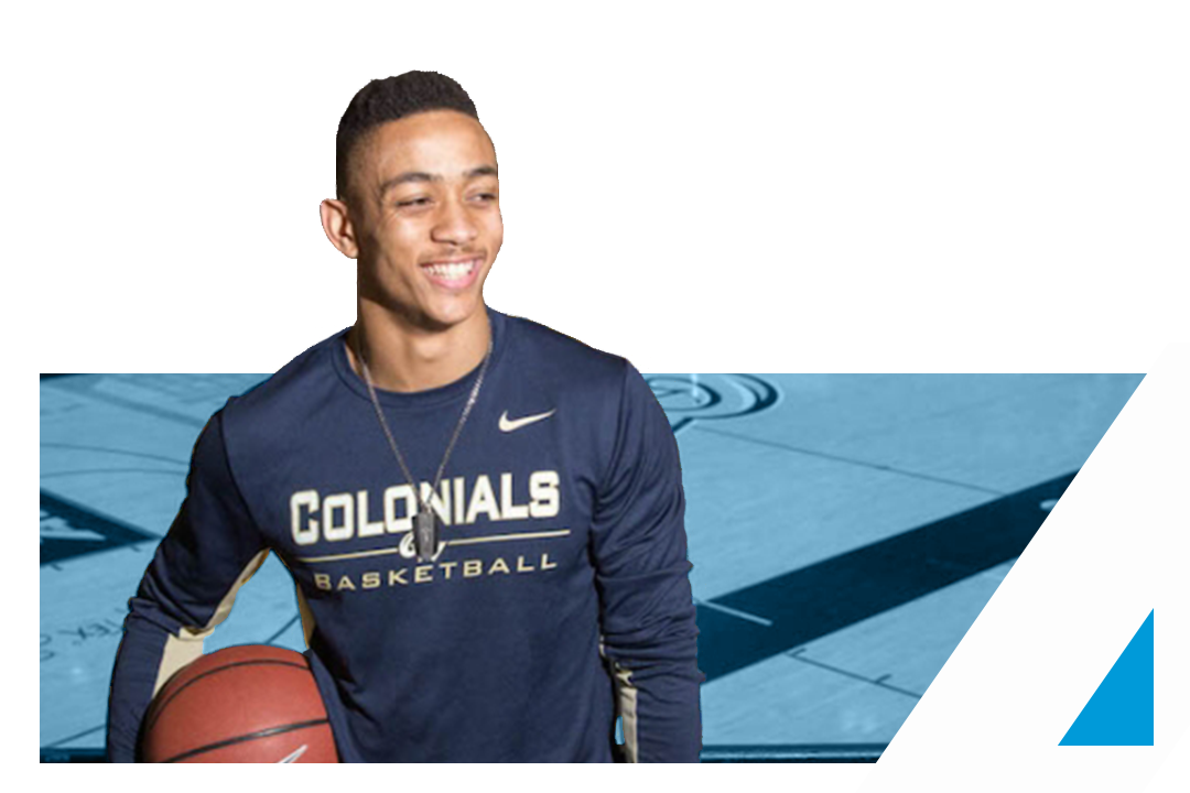 GW Alum Joe McDonald holding a basketball and smiling in his GW basketball uniform.