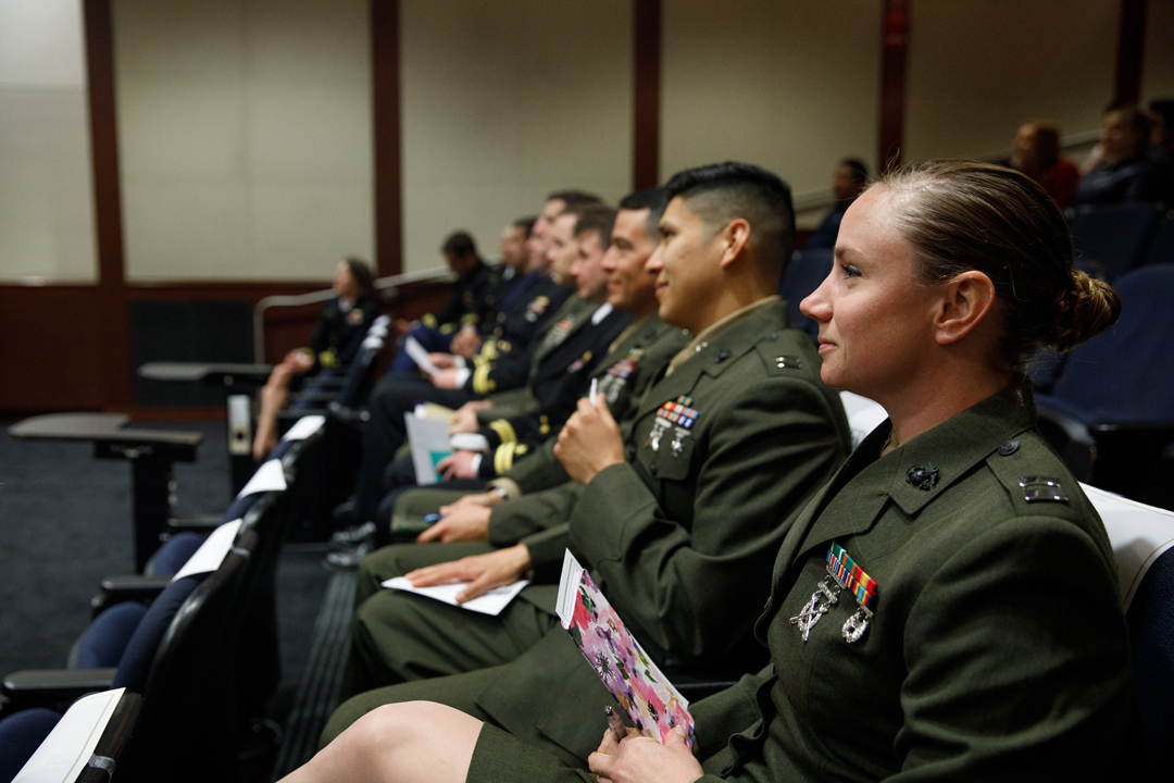 a row of military officers sitting in an auditorium